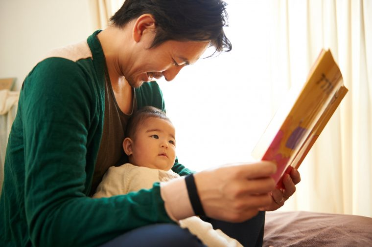 A father reading to his child