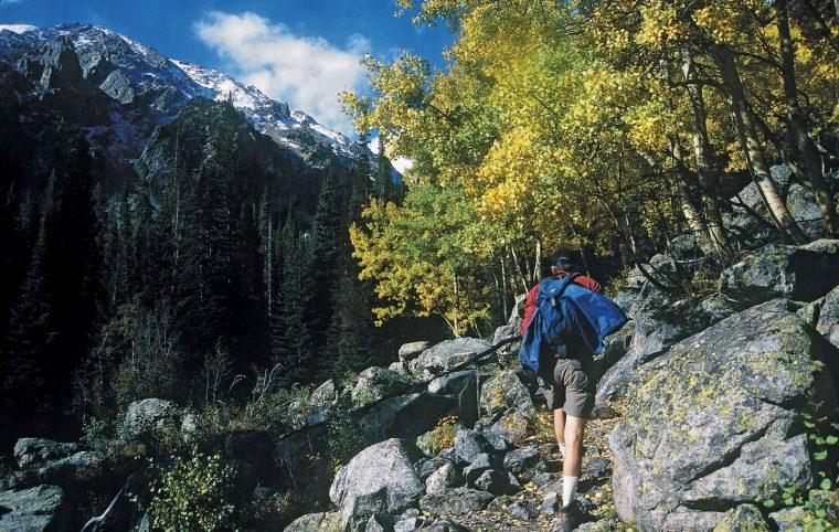 Man hiking up a mountain
