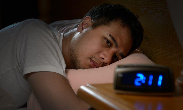 man-staring-at-clock-768