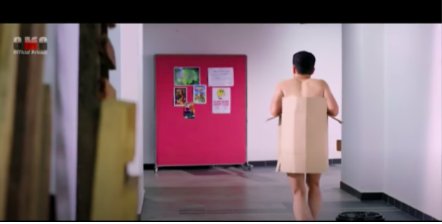 Badrol walking around wearing a cardboard box