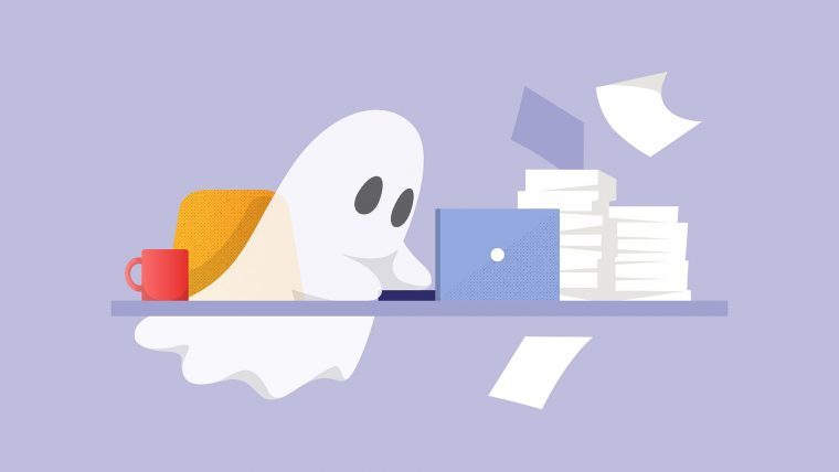 A ghost typing on a laptop