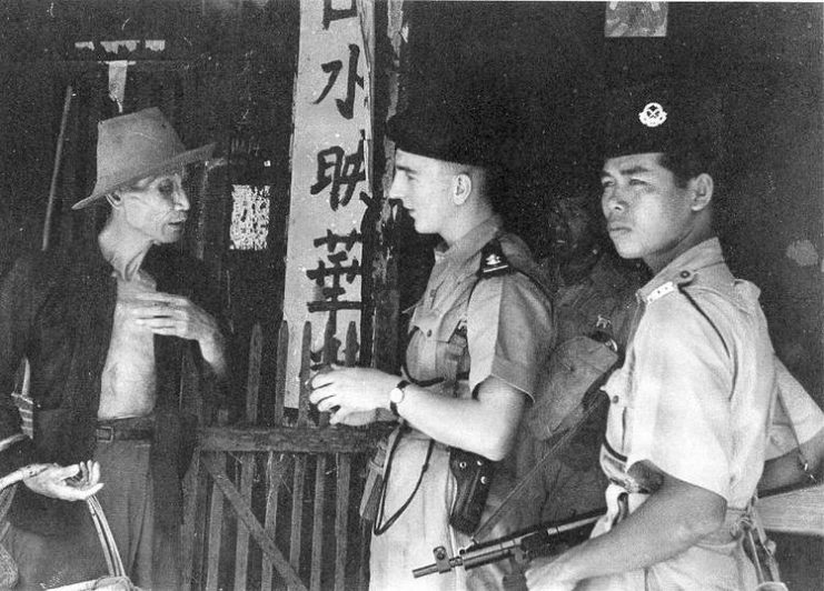 british soldier chatting with an old chinese man