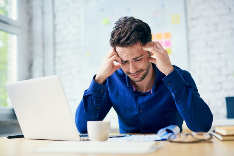 Man crying in front of his computer