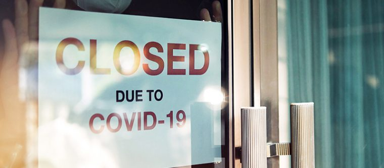 """A restaurant sign that says """"Closed Due To COVID-19"""""""