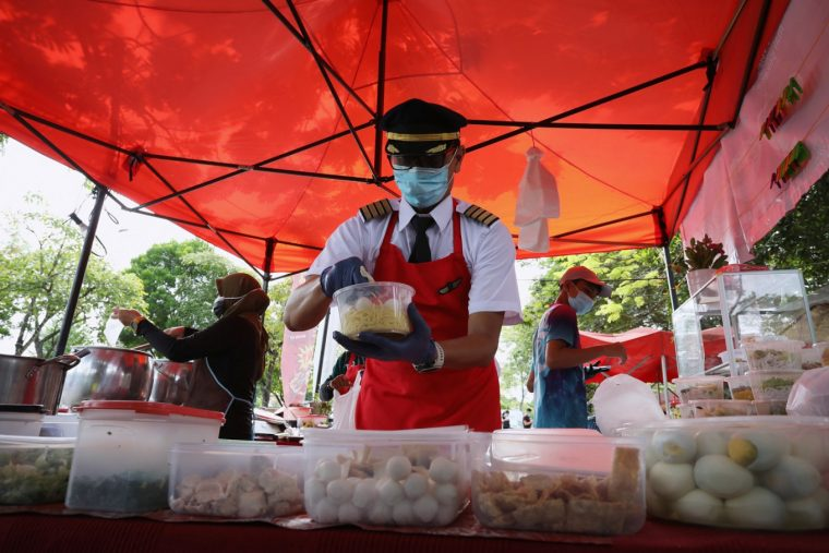 Pic of Malaysian Pilot serving food