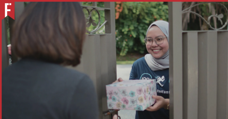 A girl sending a package to someone