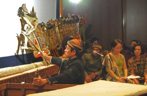 A puppeteer doing wayang kulit