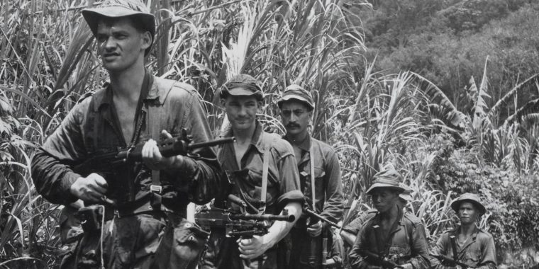 soldiers fighting against communist insurgents in the jungles of Malaysia