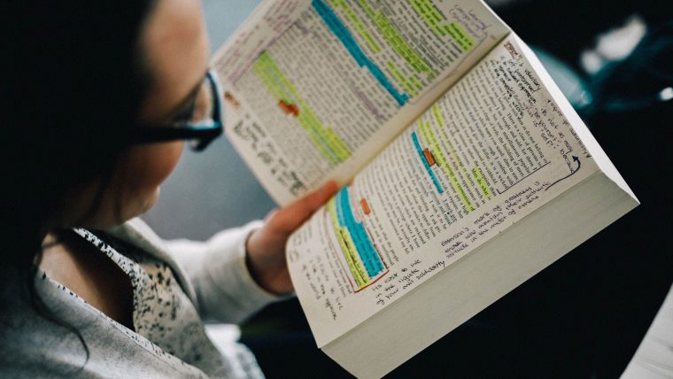 a woman annotating a book