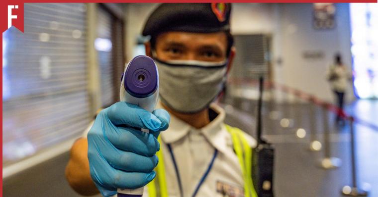 security guard taking temperature