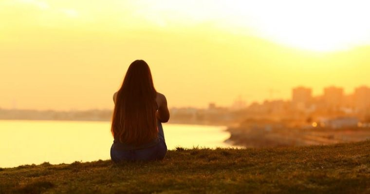 woman taking a break and looking at the sunset