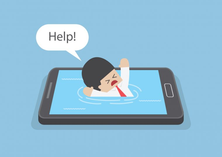 A man drowning in his phone